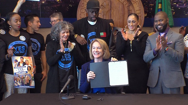 City Council resolution endorsing I-940 signed by Mayor Durkan