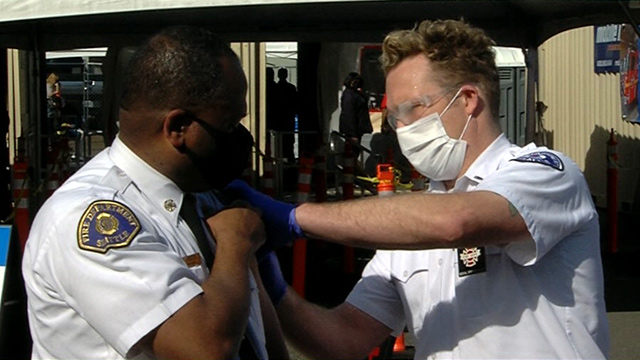 Seattle Fire Chief Harold Scoggins receives COVID-19 vaccine